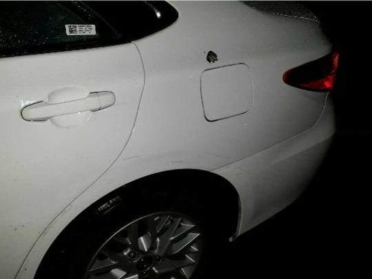 The bullet hole damage in a Toyota Camry that was shot at Monday night.
