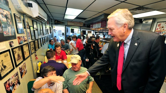 Republican Sen. Luther Strange shakes hands with Jackson Como and David Hodges while they eat breakfast at Salem's Diner Tuesday, Sept. 26, 2017, in Birmingham, Ala. Voters will choose between former state Supreme Court Chief Justice Roy Moore and Strange in a race that brought President Trump and other political heavyweights to Alabama.