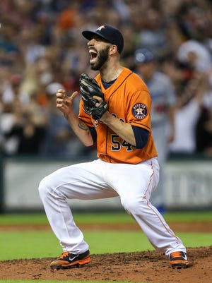 Mike Fiers celebrates baseball's fifth no-hitter of the season.