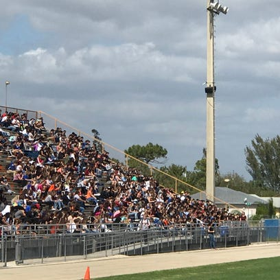 Cape Coral High School students gather in the football