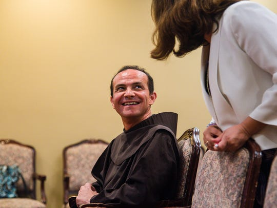 The Rev. Stefano M. Cecchin enjoys a moment with a