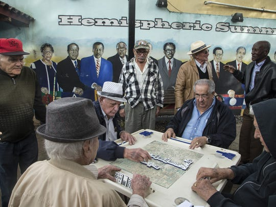 Cubans play dominos with their friends at Domino Park,