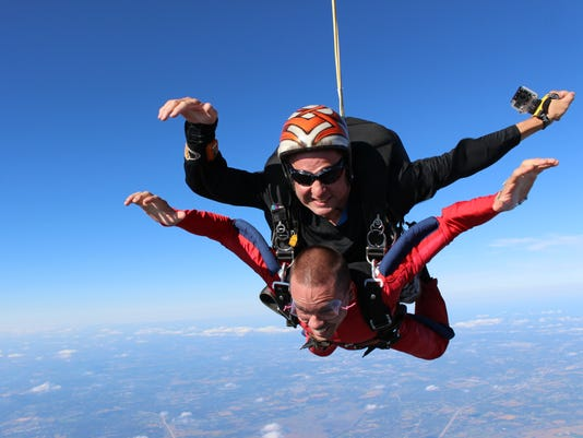 Parachuting priest
