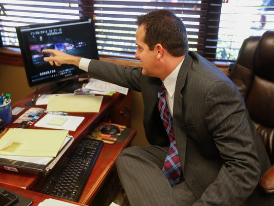 Attorney Joshua Roberts points to a portion of a video