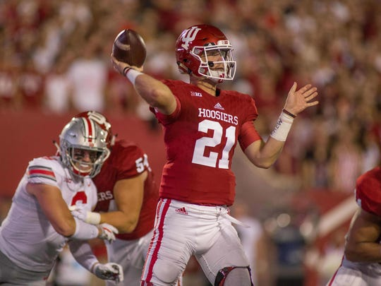 Indiana Hoosiers quarterback Richard Lagow (21) passes the ball in the first quarter of the game against the Ohio State Buckeyes at Memorial Stadium.