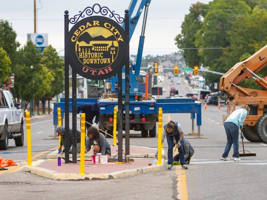City employees, community leaders and volunteers help clean up downtown Cedar City during an event on Saturday, September 23, 2017.