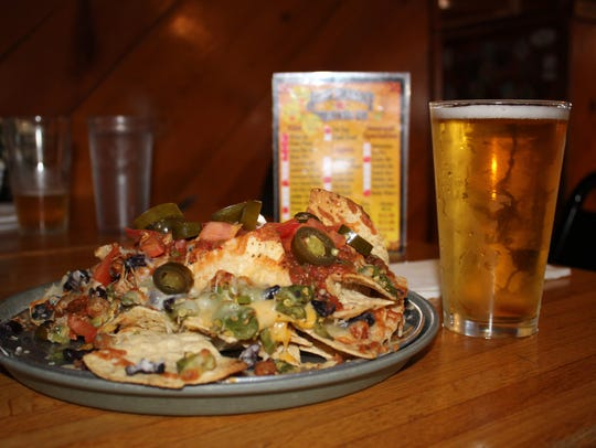 The Peach Wheat (pint - $3.75) and the Nachos are recommended