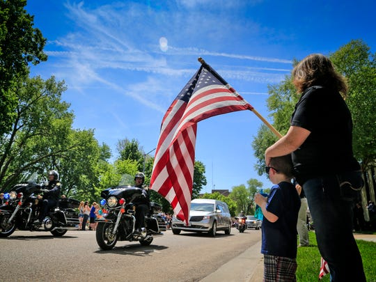 Jenni Glomb of Council Bluffs stands with her son Tucker,