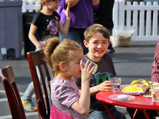 Some youngsters enjoyed some of the tasty food at Cornerstone's drive-thru ribbon cutting ceremony April 19.