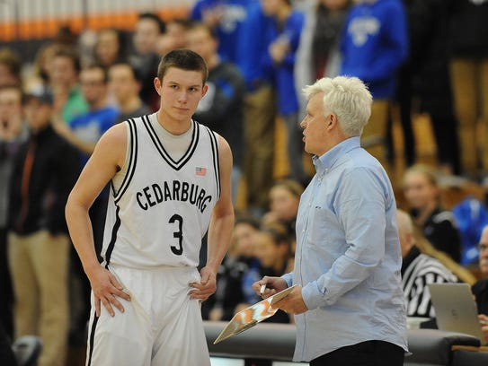 Cedarburg coach Tom Diener speaks with his standout