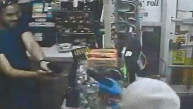 Surveillance footage showing Jeremy Donohue preparing to shoot Anton Kirby. Prosecutors said Kirby was attempting to rob the Harrison Food Mart, and Donohue was defending himself.