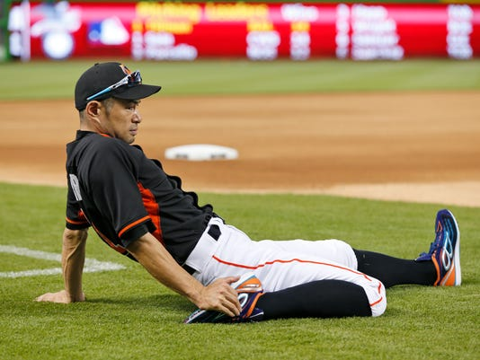 Miami Marlins' Ichiro Suzuki, of Japan, stretches out before the start of a baseball game against the Philadelphia Phillies, Tuesday, July 26, 2016, in Miami. (AP Photo/Wilfredo Lee)