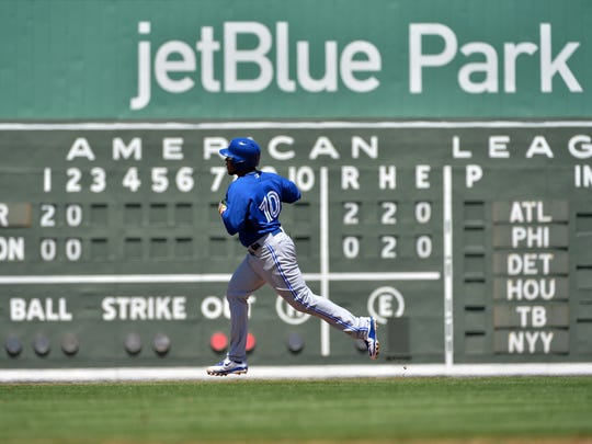 Apr 1, 2015; Fort Myers, FL, USA; Toronto Blue Jays first baseman Edwin Encarnacion (10) rounds the bases after hitting a solo home run during the third inning against the Boston Red Sox at JetBlue Park. Mandatory Credit: Steve Mitchell-USA TODAY Sports