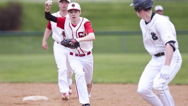 Champlain Valley second baseman Tyler Skaflestad, left, chases down St. Johnsbury's Patrick Greenan during Saturday's high school baseball game in Hinesburg.
