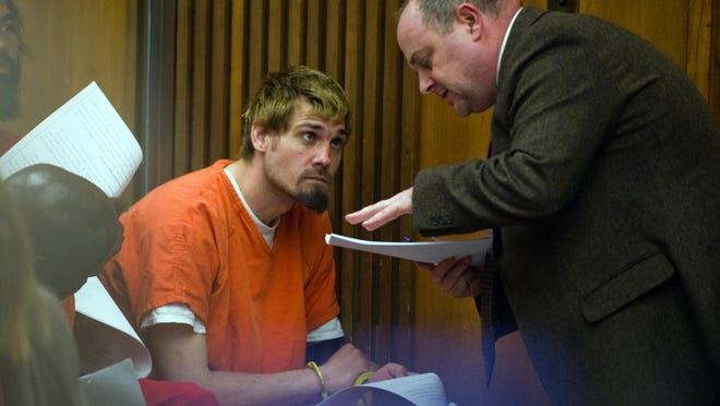 Richard Robinson, left, talks with Public Defender Adam Grace during a court appearance in 2016 on charges that he killed his 87-year-old grandfather in Stockton and another man in Sacramento. Robinson was convicted July 1 of two counts of murder with the special circumstances of burglary and robbery