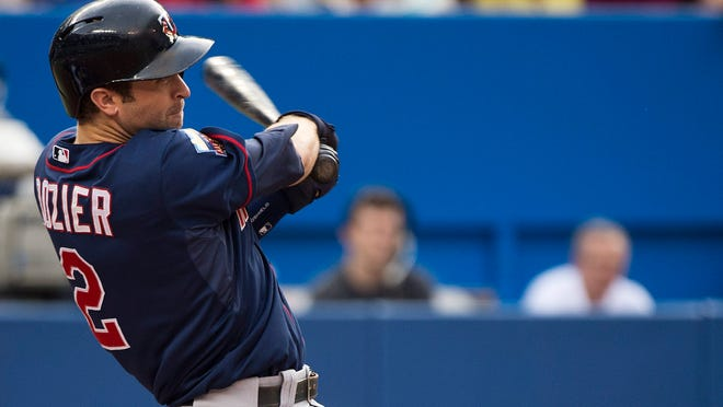 Minnesota Twins Brian Dozier hits a two-run home run against the Toronto Blue Jays earlier this month.