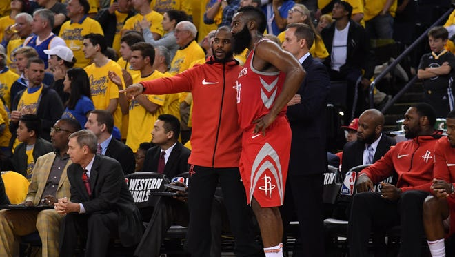 Houston Rockets guard Chris Paul (left) talks with guard James Harden (13) against the Golden State Warriors in the second half in game six of the Western conference finals of the 2018 NBA Playoffs at Oracle Arena.