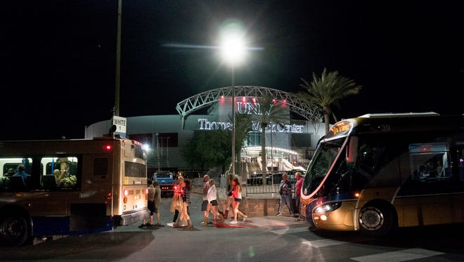 People load into buses destined to different Strip Casinos following a mass shooting at the Route 91 music festival along the Las Vegas Strip, Monday, Oct. 2, 2017. UNLV's Thomas & Mack Center was opened as a place of refuge.