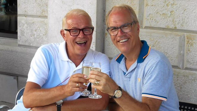 What could Chuck Leachman (left) and Mickey Feigelson of Palm Springs be toasting? Perhaps, finding their dream home.