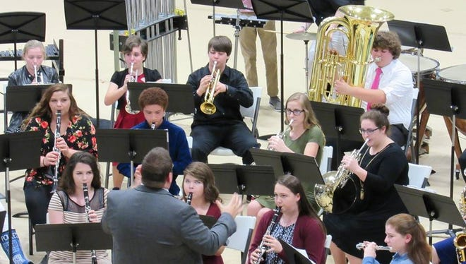 UCMS band preforms during the concert.