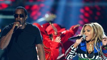In this Sept. 19, 2015, file photo, Puff Daddy, left, performs with Lil Kim at the 2015 iHeartRadio Music Festival in Las Vegas. Puff Daddy is reuniting with Lil Kim, Mase, Faith Evans and more for a Bad Boy Records reunion tour kicking off Aug. 25, 2016, in Columbus, Ohio. (Photo by Al Powers/Powers Imagery/Invision/AP, File)