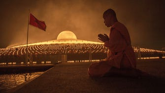 TOPSHOTS A Buddhist monk prays during a ceremony at the Dhammakaya Temple in Bangkok on March 4, 2015 on the occasion of Makha Bucha day. The Makha Bucha festival is observed in Thailand on the full moon of the third lunar month and commemorates the day when 1,250 monks gathered to be ordained by the Buddha. AFP PHOTO / Nicolas ASFOURINICOLAS ASFOURI/AFP/Getty Images ORIG FILE ID: 538517016