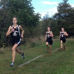 Ryan Talbott of Pinckney edges to the front as the Pirates and Hartland break from the start line in their dual cross country meet on Tuesday at Hudson Mills Metropark. Talbott, who took second, has eventual winner Austin Wicker to his right and third-place Isaac Harris to his left.