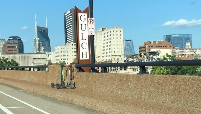 Two dockless motorized Bird scooters were left at the Church Street Bridge on June 6, 2018.