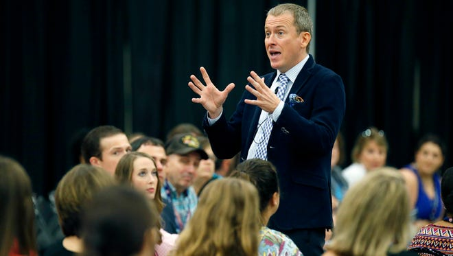 Ron Clark, a nationally acclaimed professional educator, motivational speaker and trainer from Atlanta and co-founder of the Ron Clark Academy, addresses teachers, school administrators and educators from throughout Mississippi on July 22 during first session of a two-day legislative hearing/summer education forum in Jackson. The forum, sponsored by Rep. Jay Hughes, D-Oxford, was designed to encourage and improve the quality of classroom instructional time with low-cost ideas.
