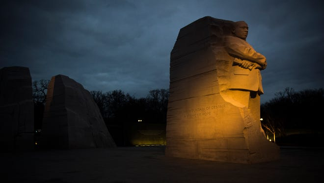 Early morning  light shines on the Martin Luther King Jr. Memorial on the National Mall on January 19, 2015 in Washington, D.C.