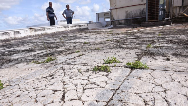Cracks can be seen riddling the insulating membrane on the rooftop of the Guam Memorial Hospital on Tuesday, Jan. 30, 2018.