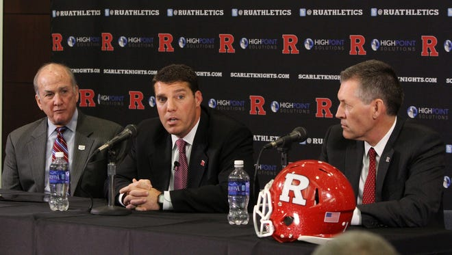 Rutgers football coach Chris Ash (center) met Monday night with New Jersey high school football coaches to share his vision.