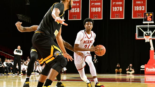 Michael Weathers drives to the basket Sunday at Millett Hall.