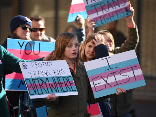 Madison Boylan, 12, center, of Atlantic Highlands, a transgender student, participates with her family during Sunday's rally.