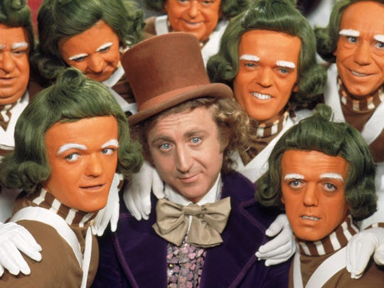 "Gene Wilder (center, with Oompa Loompas) stars as the title candy man in ""Willy Wonka and the Chocolate Factory."""