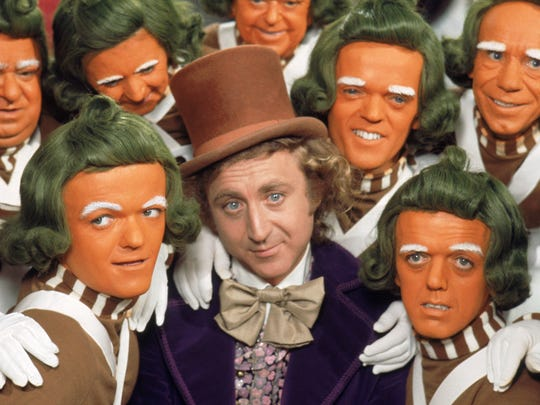 """Gene Wilder (center, with Oompa Loompas) stars as the title candy man in """"Willy Wonka and the Chocolate Factory."""""""