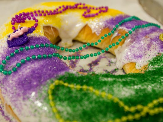 A finished king cake waits to be boxed up for customers at Montgomery Bakehouse in Conroe, Texas.