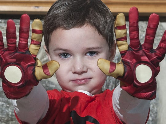 Max Levy, who has hemophilia poses with his Iron man costume at his home in Voorhees. He is featured in Marvel's latest Iron Man comic.
