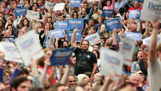 Supporters cheer as Democratic presidential candidate Sen. Bernie Sanders speaks at a political rally in Madison, Wis., Wednesday, July 1, 2015. (Michael P. King/Wisconsin State Journal via AP)