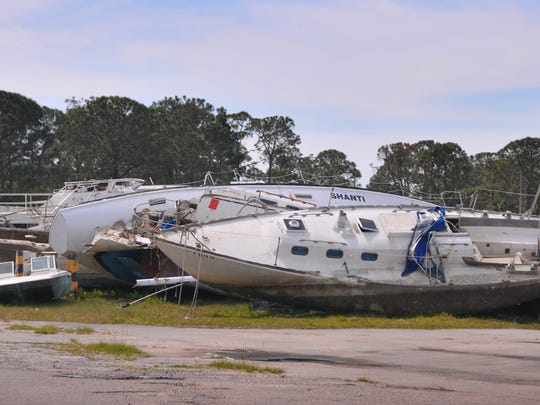 Derelict boats already removed from the water are in temporary storage on land off Dowling Circle in Sharpes.