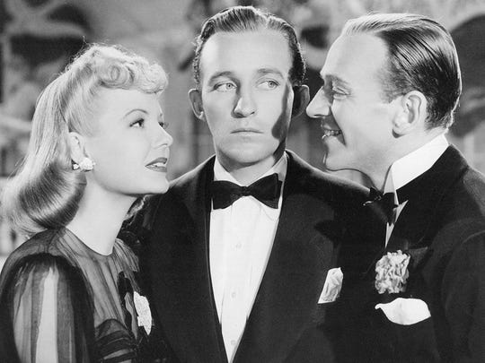 """Marjorie Reynolds (left), Bing Crosby and Fred Astaire star in """"Holiday Inn."""""""