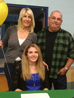 Katie Ladd, here joined by parents Sharon and Robert Ladd, has signed to play volleyball at Belhaven University in Jackson, Miss.