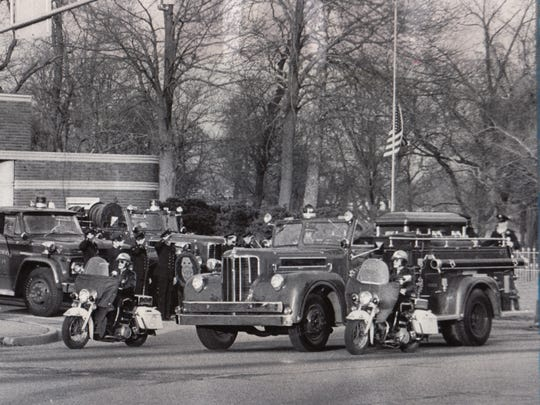 Cortege for Indianapolis Fire Department Pvt. Jerry A. Poole passing Station 18, 3130 W. Washington St. January 18, 1973. Pvt. Poole and Pvt. Raymond R. Moore died in a collision between their engine and a passenger car when on an emergency run January 15, 1973.