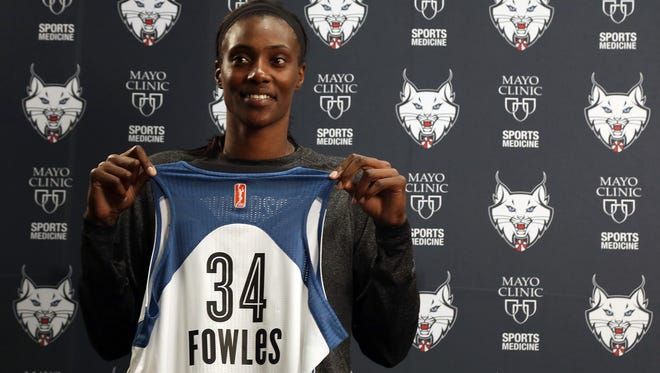 Minnesota Lynx center Sylvia Fowles holds her jersey during an introductory news conference Tuesday at the Mayo Sports Clinic in Minneapolis. The Lynx parted with two players and a first-round draft pick for the 29-year-old Fowles, a two-time Olympian.