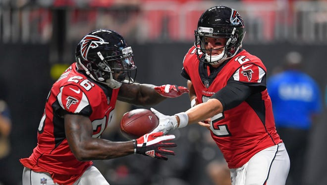 The Atlanta Falcons had the No. 8 offense in the NFL last season, but quarterback Matt Ryan, right, and running back Tevin Coleman aren't getting much respect from fantasy drafters.