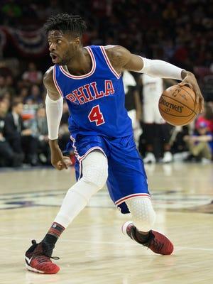 Philadelphia 76ers forward Nerlens Noel (4) dribbles against the Miami Heat during the second quarter at Wells Fargo Center.