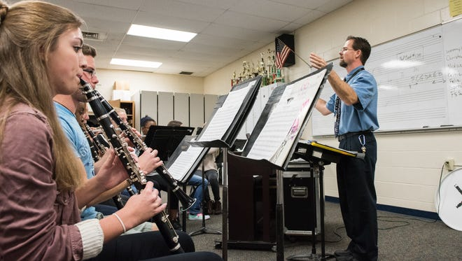 Mardela High School Band Director, Cory Boltz, leads his students during a rehearsal on Thursday, Dec. 1, 2016.