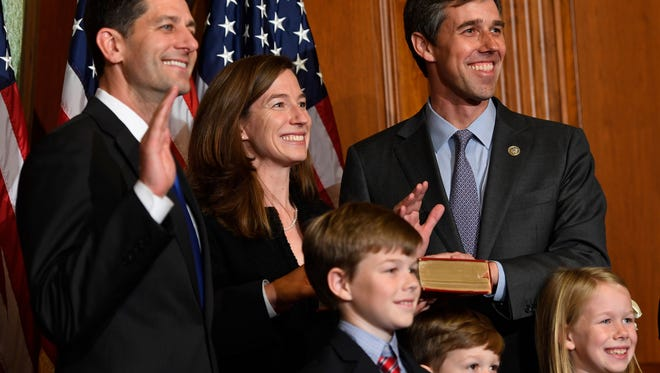 Rep. Beto O'Rourke, D-Texas, stands with House Speaker Paul Ryan, R-Wisconsin, for a ceremonial swearing-in and photo-op during the opening session of the 115th Congress.