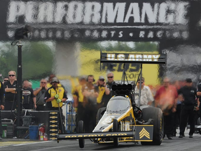 Top Fuel Driver Tony Schumacher leave the starting line  during the NHRA US Nationals at Lucas Oil Raceway, Sat. Aug 30, 2014.