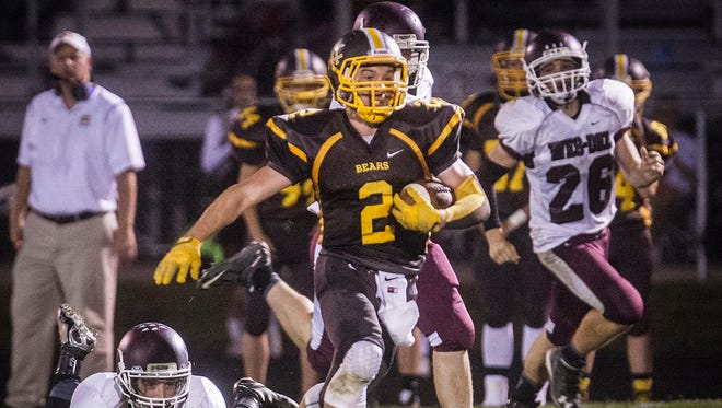 Monroe Central's Beau Combs runs against Wes-Del during their game at Monroe Central High School on Friday, Sept. 25, 2015.
